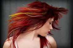 Feathers in her Red Hair Message:  Wild creativity, independent thinking, free spirit, passion.