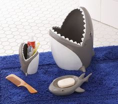 Shark Bathroom - I bet you could make the back two of these by cutting the heads off toy plastic sharks and sealing the bottom
