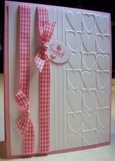 sweet handmade Valentine card ... Cuttlebug hearts embossing folder ... pink ribbons ... tiny tag message ...