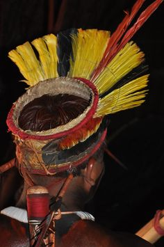 Kuarup: Brazilian indian from Mehinaku tribe with colourful headress used for a ceremony called Kuarup in the Xingu National Park, Mato Grosso. #travel