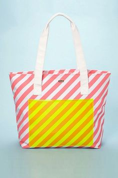 A diagonal stripe with contrasting neon makes a playful statement. #refinery29 http://www.refinery29.com/beach-bags#slide-14