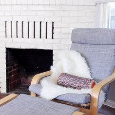 Pasadena Cottage - Ikea Poang Chair in Isunda Grey with Faux Sheepskin and log pillow!
