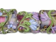 Stunning. Buying for a bracelet for mom. Shhh...Don't tell her. It's a secret. Purple Flowers with Purple and Hot Pink Center Mix Pillow Beads (7pcs)