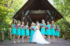 Aqua / Tiffany Blue bridesmaids dresses and hot pink bridesmaids bouquets. The color came out a bit more blue on the picture, but in reality, it was more aqua.