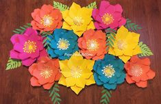 Handmade paper flower sets Made for birthdays, decorations , or any event. Made to order. Turn around time is 1-2 weeks from ordering date. Please message me prior to ordering to make sure you will receive them on time. If need sooner please message me prior to ordering thank you. *