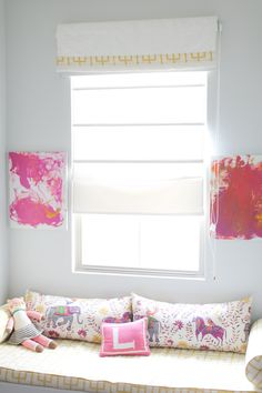 We really love the energy of this bright pink & yellow girl's room! It is full of light and girly details.