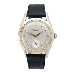 Longines wrist watch, gold on steel from 1954 via MarCels. Click on the image to see more!