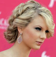 twist back around face. tight curls pinned opposite direction