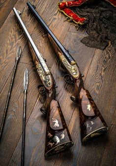 Elaborately decorated double rifles for show. Plain Jane's were the original working guns of Africa and the white hunters of early African fame.ur guns and I'm arrows ❤️💋❤️African rifles for big-game. These double-barreled Holland & Hollands