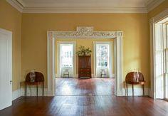 Yellow walls + hardwood floors.