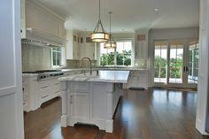 Kitchen-Island with leg space, white counter, sinks, windows