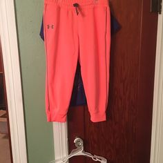Under armour neon orange cropped soft pants Size small or youth xlarge Under Armour Pants Track Pants & Joggers