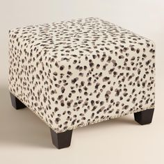 Featuring a neutral leopard print on an off-white ground, our plush, custom-made ottoman is handcrafted in the U.S.A. with cotton upholstery and nail trim. Pair two ottomans at the foot of a bed for dramatic seating and coordinate with our headboard in the same custom fabric or bed in a complementary solid hue for a pulled together look.