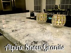 Gorgeous, reflective white granite...or is it? Sprucing up laminate to get an amazing faux granite!!!