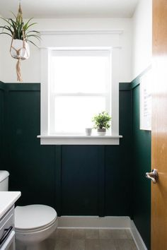 Bathroom Remodel Modern Green Bathroom Makeover This green bathroom makeover is incredible! Check out that DIY window trim and board and batten she added to her tiny bathroom. Super pretty and that dark green paint is gorgeous. Zen Bathroom, Modern Bathroom, Bathroom Ideas, Bathroom Makeovers, Master Bathroom, Downstairs Bathroom, Bathroom Organization, Bathroom Window Decor, Guys Bathroom