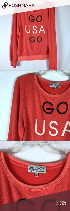 """Wildfox Go USA Go Top -Distressed look -47% polyester, 47% rayon, 6% spandex -Oversized, loose fit -Chest (underarm to underarm): about 23 1/2"""" -Length (from shoulder): about 26 1/2"""" -Some wash wear. Top has a """"pilled"""" look as part of the distressed look. Wildfox Tops Sweatshirts & Hoodies"""