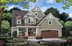 This two-story cottage garners curb-appeal from multiple gables accented with decorative brackets, metal roof details, and arched entries to the garage and front door. The Abigail house plan 1488 is now available! 2465 sq ft | 4 Beds | 4 Baths #wedesigndreams #cottage #twostory