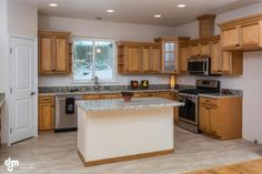 Kitchen. . This lovely home is listed for $498,000; Bedrooms: 3; Total Baths: 2; Garage:2; Year Built: 2015 Sq. Feet: 2,232; Lot size: 1.25 acres; Heat: Forced Air. To learn more about the property, visit: http://lesbaileyteam.com/listing/mlsid/3/propertyid/15-330/