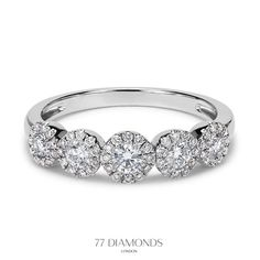 With 70 diamonds and 5 halos, this Bahira eternity ring is the only one you need