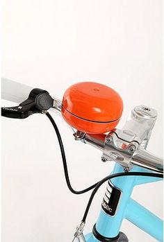 Republic Oversized Bike Bell: A big orange bike bell from urban outfitters (seen on dwell.com)
