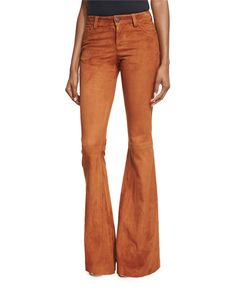 Alice + Olivia suede pants in lambskin. Five-pocket style. Fitted with flare legs. Button/zip front; belt loops. Lining: polyester/spandex. Professional leather clean. Imported.