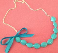 Aqua necklace - see more on http://themerrybride.org/2014/05/05/aqua-pink-and-orange-wedding/