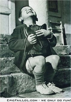 A 6-year-old orphan receives a gift from Red Cross in 1946. / This, to me, is one of the most touching photographs I have seen.  What sheer joy and appreciation this little guy shows.