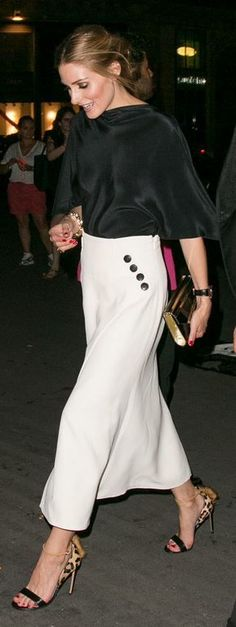 Who made Olivia Palermo's white skirt, leopard fringe sandals, and gold clutch handbag?