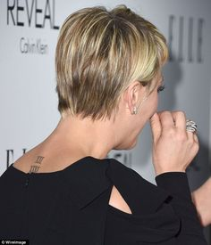 Permanent love: Kaley showed off the tattoo on her neck, which is her wedding date in Roma...