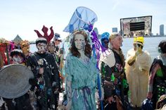 Earth Celebrations Hudson River Pageant, New York City. River Maiden with skirt bustle of river debris and river cleansing skimmer. Costume by Becky Hubbert. Photo by Christopher Butt.