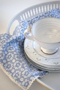 blue and white patterned napkin gives plainer china some interest