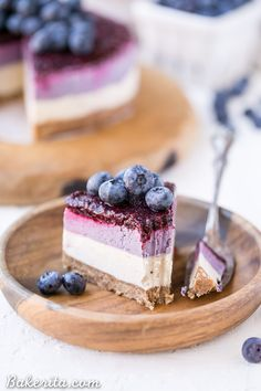 This No-Bake Layered Blueberry Cheesecake is a beautiful and easy-to-make Paleo-friendly + vegan cheesecake made with soaked cashews! The cheesecake layers are lusciously smooth and creamy with a tart, fruity topping.