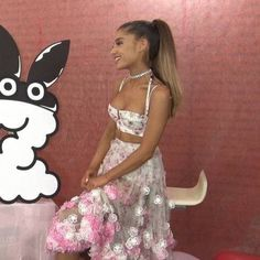 Ariana Grande looking at a drawn photo of a bunny dressed as dangerous woman.:).