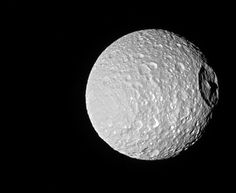 NASA has published a new photo taken by the Cassini space probe of Mimas, one of Saturn's moons, which provides an excellent perspective view of the mountain in the center of Herschel crater, which is not huge in absolute terms but has a diameter which is almost a third of that of Mimas. The mountain is high even by Earth standards with at least 6 kilometers (4 miles) above the crater's floor and stands out even more on the small moon. Read the details in the article!