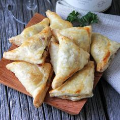 These bite-sized turnovers are bursting with flavors of herbs, tangy cheese, and rich mushrooms.