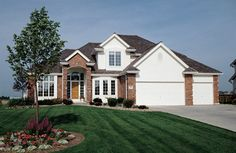 This luxury home combines formal features and casual, family-friendly areas with an elegant exterior.  Luxury House Plan # 121076.