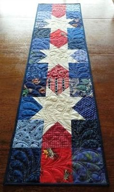 "I have seen a lot of patriotic runners, but I really like the colors in this one! Quilted Patriotic Table Runner Western Star Table Runner ""I have seen a Star Quilt Blocks, Star Quilts, Mini Quilts, Sampler Quilts, Table Runner And Placemats, Quilted Table Runners, Quilted Table Runner Patterns, Table Topper Patterns, Patchwork Table Runner"
