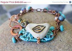 On Sale Mixed media bird bracelet in copper by honeyandollie, $40.18