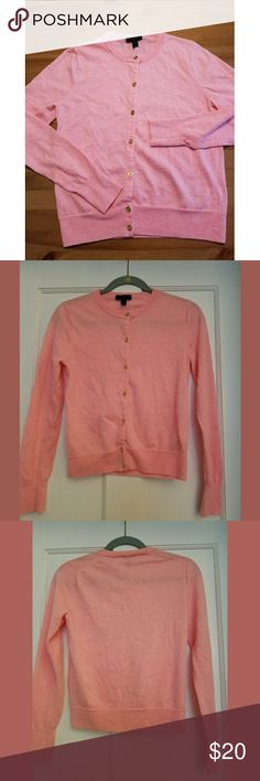 "J. Crew 100% Merino Wool Pink Cardigan SZ M Love this peachy pink 100% merino wool super soft cardigan from J. Crew with gold buttons down the front. 20"" long, 17"" across bust. Perfect condition with the exception of one single hole on inside the right sleeve. Not very noticeable and otherwise in perfect wearable condition. Priced accordingly due to flaw. Please be sure to look at all photos to see the hole. J. Crew Sweaters Cardigans"