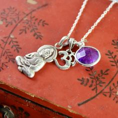 Dharmashop.com - Amethyst and Sterling Serenity Buddha Necklace , $74.00 (http://www.dharmashop.com/amethyst-and-sterling-serenity-buddha-necklace/)