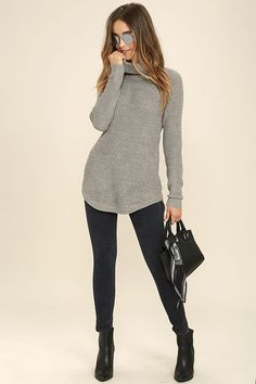 Count on the Lean On Grey Turtleneck Sweater for all those cozy days indoors! Grey knit is soft as can be, creating a relaxed turtleneck and long sleeves with ribbed cuffs. Long, wide-cut bodice has a slight high-low hem.