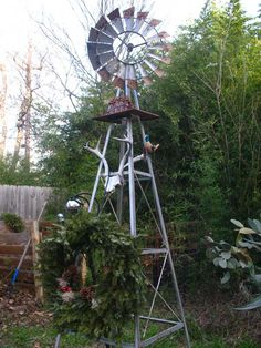 a garden windmill - I have heard that the movements of a metal windmill or whirl-a-gig discourage moles from taking up residence in your garden.