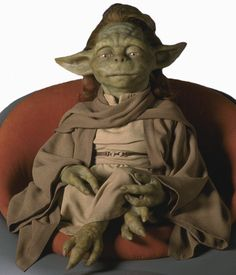 """Yaddle - Female member of Yoda's species. She is also known as """"The One Below"""". Yaddle is a member of the Jedi Council in The Phantom Menace. Iain McCaig's concept art was originally a depiction of a young Yoda, conveying youth, pain, and wisdom inspired. This work was used to create Yaddle."""