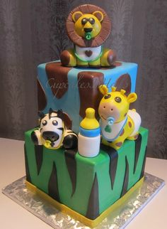 Baby Safari Animals two tier cake, a surprised baby shower cake from a dear husband to his wife!