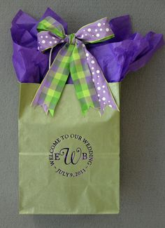 Our striking Classic Collection monogram is bold and eye-catching. The text for the circle is entirely changeable.  Your guests will love this #weddingwelcomebag filled with local goodies, bottled water & fresh fruit. We filled the bag with pansy #purpletissuepaper & used 2 #companionribbons for fun. www.favorsyoukeep.com  -512.323.0600 Our 27th Year! Austin, TX #peronalizedweddingwelcomebags #outoftownweddingguestbags #ChicagoweddingIdeas