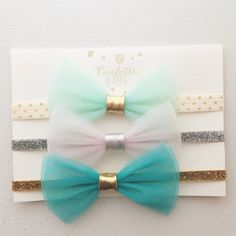Set of three Jasmine tulle bows over elastic. Please include tulle and elastic color choices as well as size in inches.