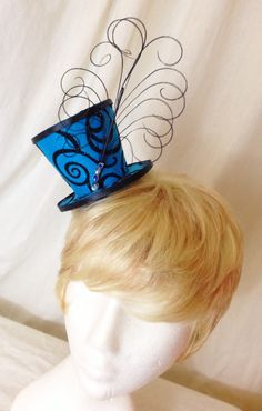 A personal favorite from my Etsy shop https://www.etsy.com/listing/236198221/blue-and-black-feathered-mini-top-hat