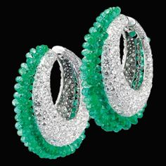 Earrings in white gold set with 1287 white diamonds of 28.32 cts and 206 briolettes emeralds of 57.79 cts.
