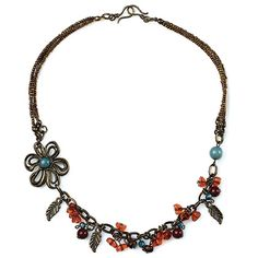 LAZY DAISY - This detailed floral necklace features delicate bronze leaves and rich crimson and orange beads with a touch of azure on an antique bronze chain.  It's beautiful on it's own or layered with a longer necklace. Measures 25 inches.