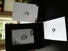 Paw print frames  Use washable black ink. Press dog or cat paw into ink pad then press into white construction paper. Make sure to have all supplies ready because if your pets are like mine, they won't have too much patience for you:) I pressed multiple paw prints so I could choose the best one to frame. Lastly, decorate as desired. I used stickers.